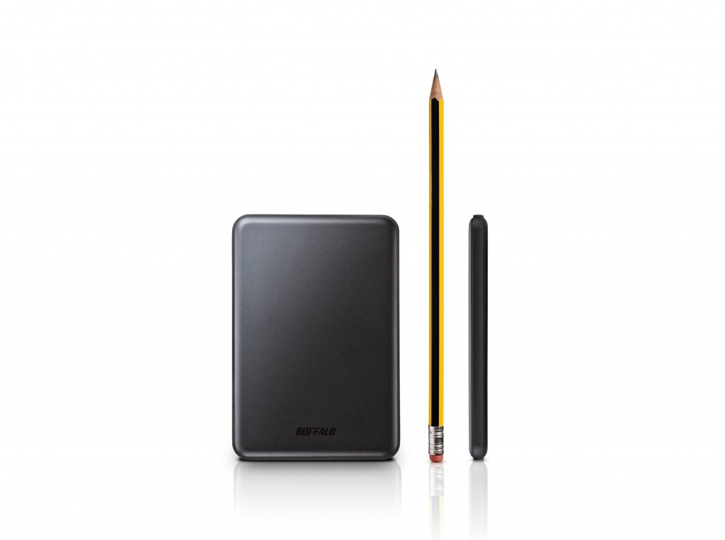 The ultraslim and light ministation slim compared to a pencil
