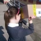 Méadhbh Ní Mhuíneachain, a pupil at Ballynacally NS in County Clare, views the solar eclipse using a pinhole camera