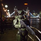"The Master Chief joins fans by Tower Bridge in London on Nov. 5, 2012 for the spectacular flight of the ""Halo 4"" Glyph to celebrate the blockbuster video game's launch on Xbox 360"