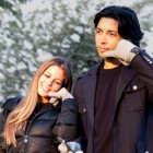 Couple using hi-call bluetooth gloves with builtin phone headset