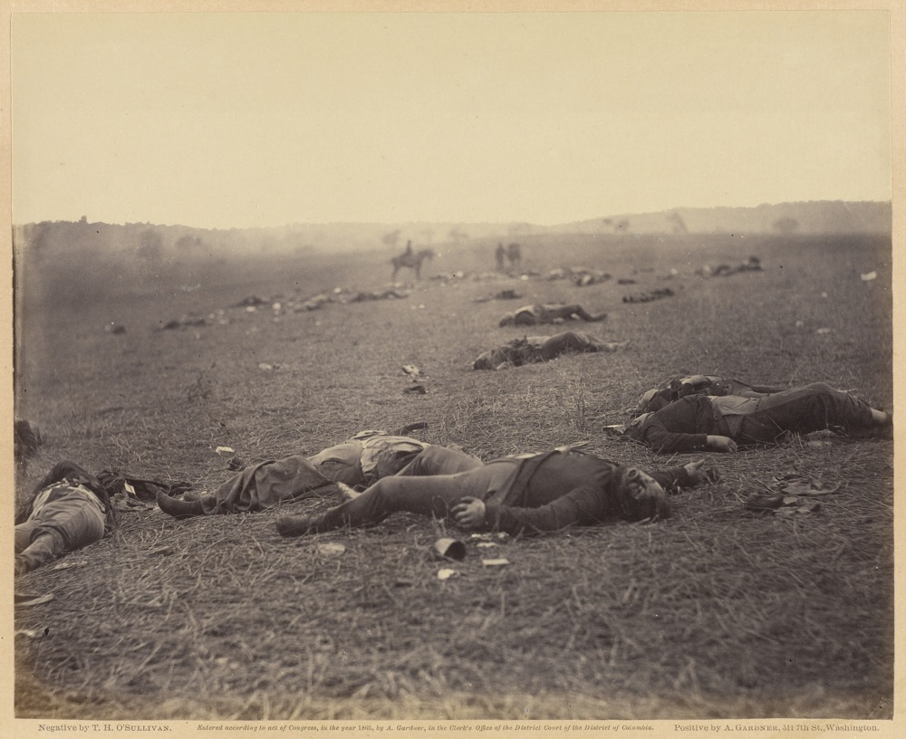 A Harvest of Death; Timothy H. O'Sullivan, American, about 1840 - 1882, Print by Alexander Gardner, American, born Scotland, 1821 - 1882; negative July 4, 1863; print 1866; Albumen silver print; Image: 17.8 x 22.1 cm (7 x 8 11/16 in.), Mount: 30.5 x 39.1 cm (12 x 15 3/8 in.); 84.XO.1232.1.36