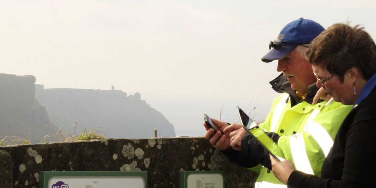 Cliffs of Moher Visitor Experience Director Katherine Webster and Cliffs Ranger Michael Hayes pictured using the new audio app
