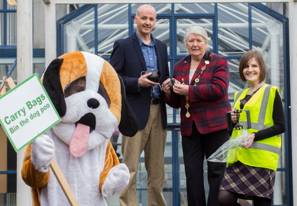 Pictured at the launch of the anti-dog fouling audio device solution in Limerick were Aidan McDermott, RiteView Solutions, Mayor of Limerick Cllr. Kathleen Leddin and Maura O'Neill, Keogh Somers and Limerick City Centre Tidy Towns along with a little help from a four legged friend. Picture: Alan Place