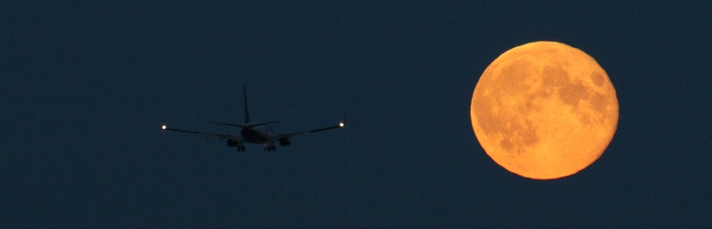 The recent 'supermoon' pictured with a plane over Dublin. Photo Credit: Astronomy Ireland www.astronomy.ie