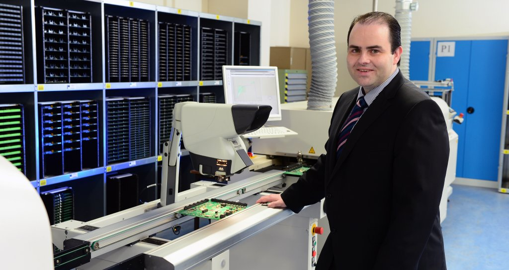 Dr Edmond Harty in the Electronic Printed Circuit Board Department at Dairymaster