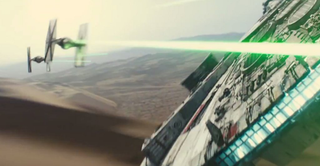 Millenium Falcon in a dogfight with TIE fighters in a scene from Star Wars: The Force Awakens