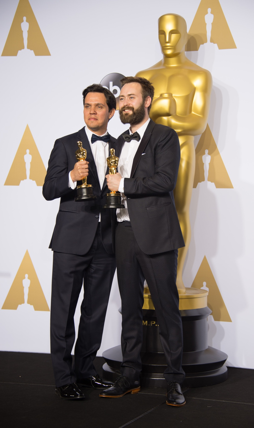 "Shan Christopher Ogilvie and Benjamin Cleary pose backstage with the Oscar® for Best live action short film, for work on ""Stutterer"" during the live ABC Telecast of The 88th Oscars® at the Dolby® Theatre in Hollywood, CA on Sunday, February 28, 2016."
