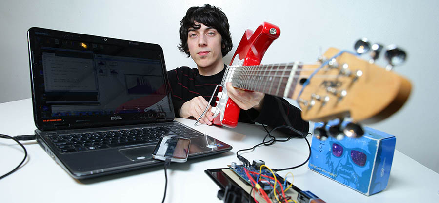 Colin Gill with his G Tune, automatic guitar tuner one of the winners at the final of the Intel 3rd level Galileo competition where students design Internet of things applications with the Intel Galileo board. Pic: Marc O'Sullivan