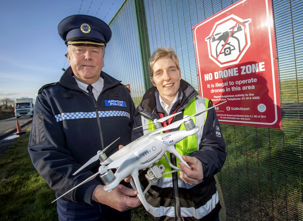 Dublin Airport Chief Police Officer, Pat Bracken and Airport Management Unit Operations Officer, Nicola Kelly at one of the No Drone Zone signs on Dublin Airport's perimeter fence