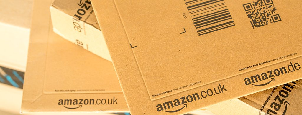 Paris France - February 08 2017: Amazon Prime Parcel Packages closeup. Amazon is an American electronic commerce and cloud computing companybased in Seattle Started as an online bookstore Amazon is become the most important retailer in the United States
