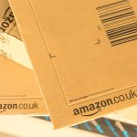Paris France - February 08 2017: Amazon Prime Parcel Packages closeup. Amazon is an American electronic commerce and cloud computing companybased in Seattle Started as an online bookstore Amazon is become the most importrant retailer in the United States